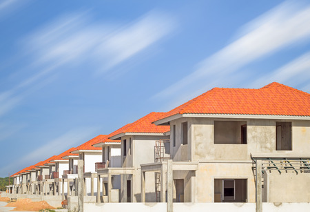 dwelling: Construction site of home with sky background.