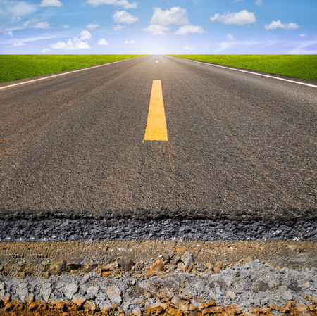 gravel roads: Cross section of asphalt road with blue sky background. Stock Photo