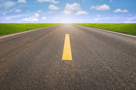 blank area: Perspective of asphalt road with blue sky. Stock Photo