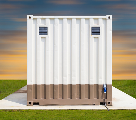Cargo container on concrete pedestal with sky background. Stock Photo