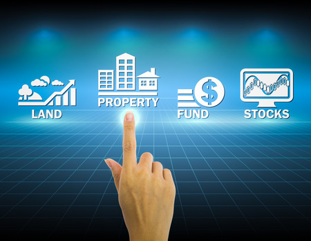 investing: Hand and investment sign with dark background.