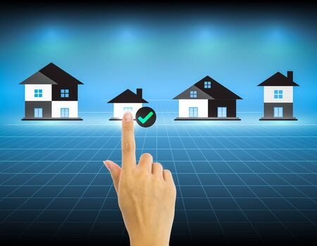 house inspection: Hand and investment sign with dark background.