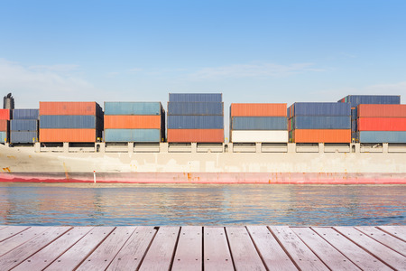 sea seaport: Cargo ship and cargo container in sea with clear sky background.