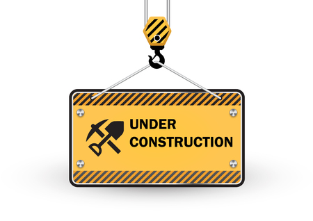 crane: Under construction sign isolated on white background. Stock Photo