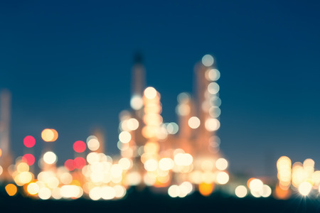 oil color: Bokeh of oil refinery at twilight, vintage color tone.
