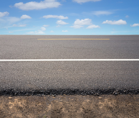 road surface: Asphalt road with blue sky background. Stock Photo