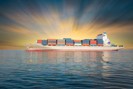 the ship: Cargo ship and cargo container in sea with clear sky background.