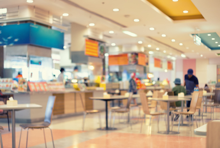 court: Defocused and blur image of food court, vintage color tone.