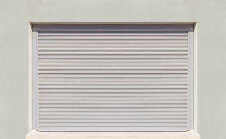 shutter door: Shutter door or rolling door, gray color.