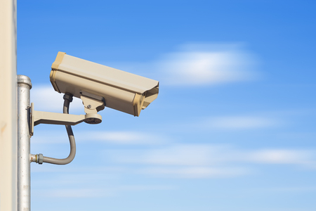closed circuit: Closed circuit camera with blue sky background. Stock Photo