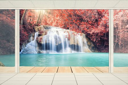 Scenery of Waterfall with door frame. Stock Photo