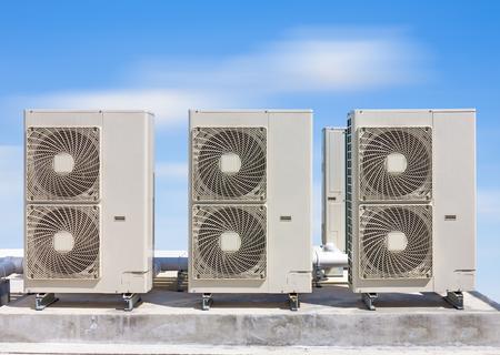 mechanical ventilation: Air compressor on concrete pedestal  with blue sky background.