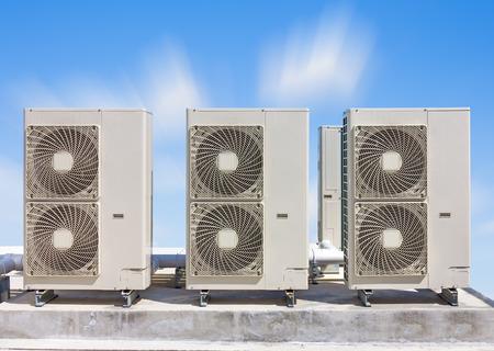ventilate: Air compressor on concrete pedestal  with blue sky background.