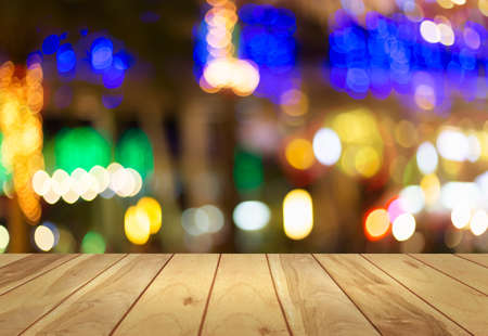 light color: Defocused of night light with wood floor. Stock Photo
