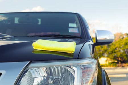 microfiber cloth: Microfiber cloth on surface of car shine. Stock Photo