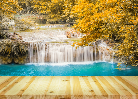 heaven background: Scenery of waterfall with yellow leaf and blue water.