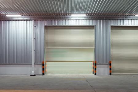 shutter door: Shutter door outside building, beige color.