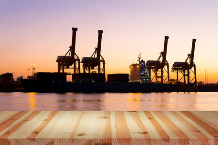 sea port: Silhouette of crane at port, twilight time. Stock Photo