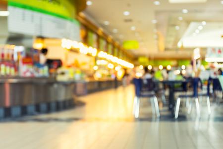 restaurant dining: Defocused or blurred photo of food court.