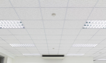 ceiling texture: Ceiling and lighting inside office building. Stock Photo