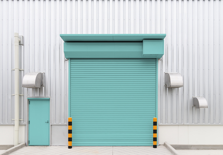 Shutter door or roller door and concrete floor outside factory building use for industrial background. Banque d'images