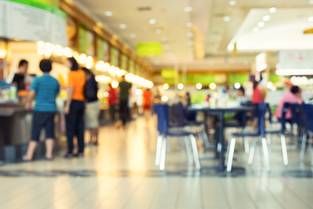 fast food restaurant: Defocused or blurred photo of food court.