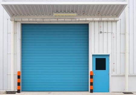 shutter door: Shutter door and steel door outside factory, blue color.