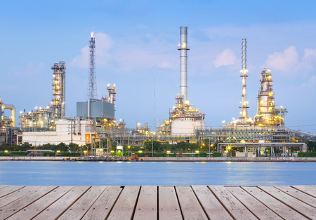 factory floor: Oil refinery at twilight with wood floor. Stock Photo