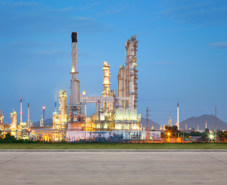 Oil refinery at twilight with concrete road. Stock Photo