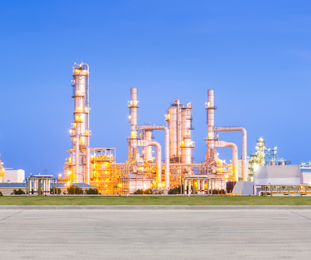 gas refinery: Oil refinery and concrete pavement at twilight.