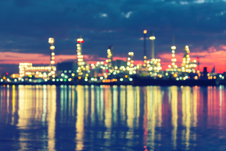 oil color: Bokeh of oil refinery factory at twilight, vintage color tone. Stock Photo