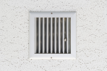 Grille of air conditioner system under ceiling. Imagens