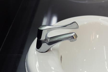 wash basin: White wash basin and faucet of bathroom. Stock Photo
