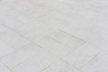 Modelo de piedra en el piso de baldosas con la línea geométrica para el fondo.
