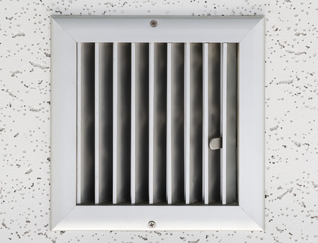 air duct: Grille of air conditioner system under ceiling. Stock Photo