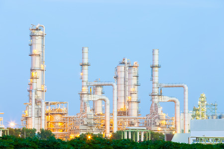 Oil refinery plant at twilight with sky background. Stock Photo