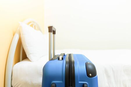 luggage travel: Bed and luggage in hotel room. Stock Photo