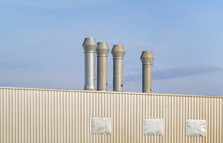roofing system: Air duct or hood for air conditioner system and roof with blue sky background.