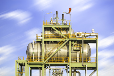 Boiler or Deaerator machine in power plant with blue sky background.