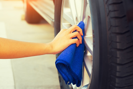 alloy: Womens hand wiping on alloy Wheels.
