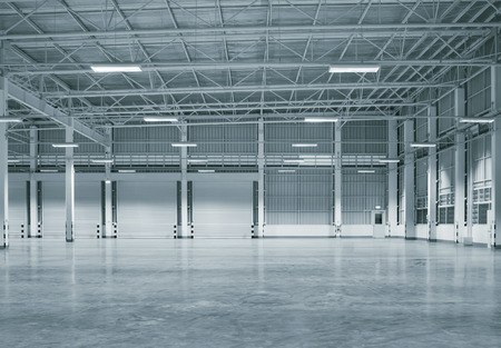 Factory building or warehouse building with concrete floor for industry background. Stock Photo