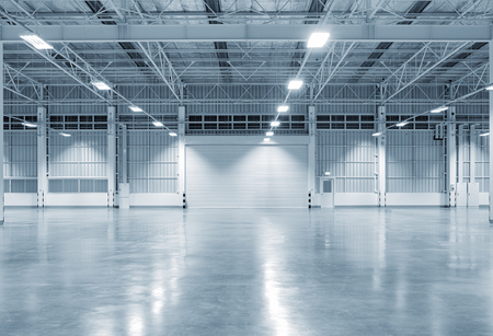 Factory building or warehouse building with concrete floor for industry background. 스톡 콘텐츠