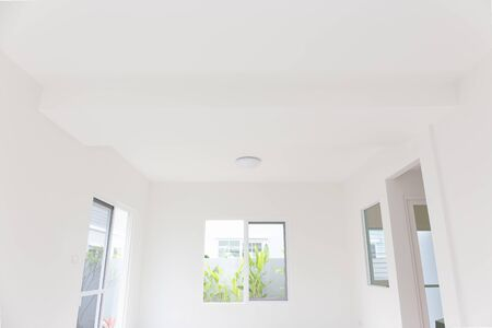Ceiling and lighting inside home building.