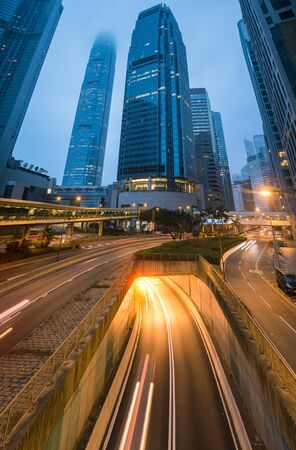 Hong kong city with light from street at twilight time.