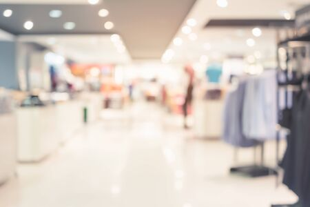 Defocus of shoppers and shopping mall for shopping business concept background.