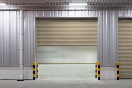 Shutter door or roller door and concrete floor outside factory building for industrial background. Stock fotó