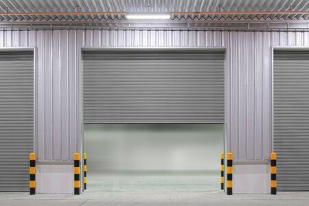 Shutter door or roller door and concrete floor outside factory building use for industrial background. Banco de Imagens