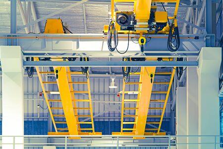 Factory overhead crane inside factory building.