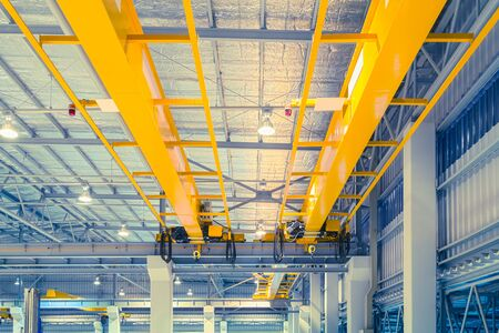 Factory overhead crane inside factory building. Фото со стока