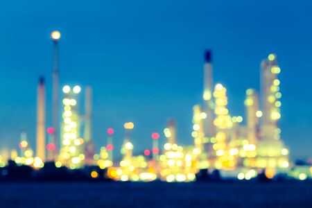 Bokeh of oil refinery at twilight.